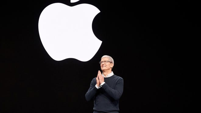 Tim Cook chief executive of Apple making announcement