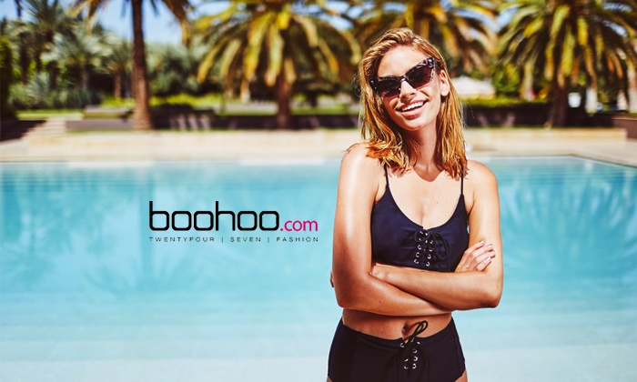 Boohoo logo in a pool with a fashion model