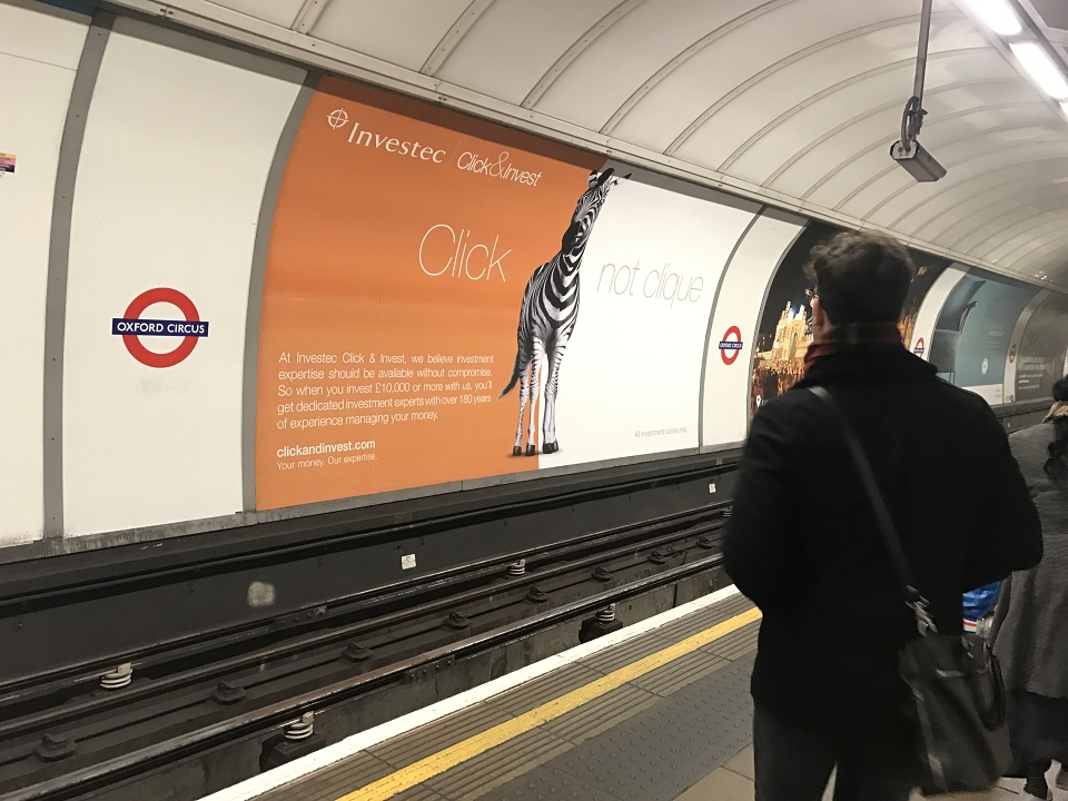 Click & Invest tube station advert