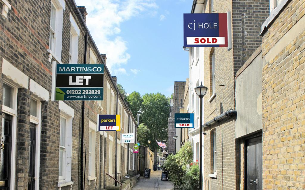 To let and sold boards in a road