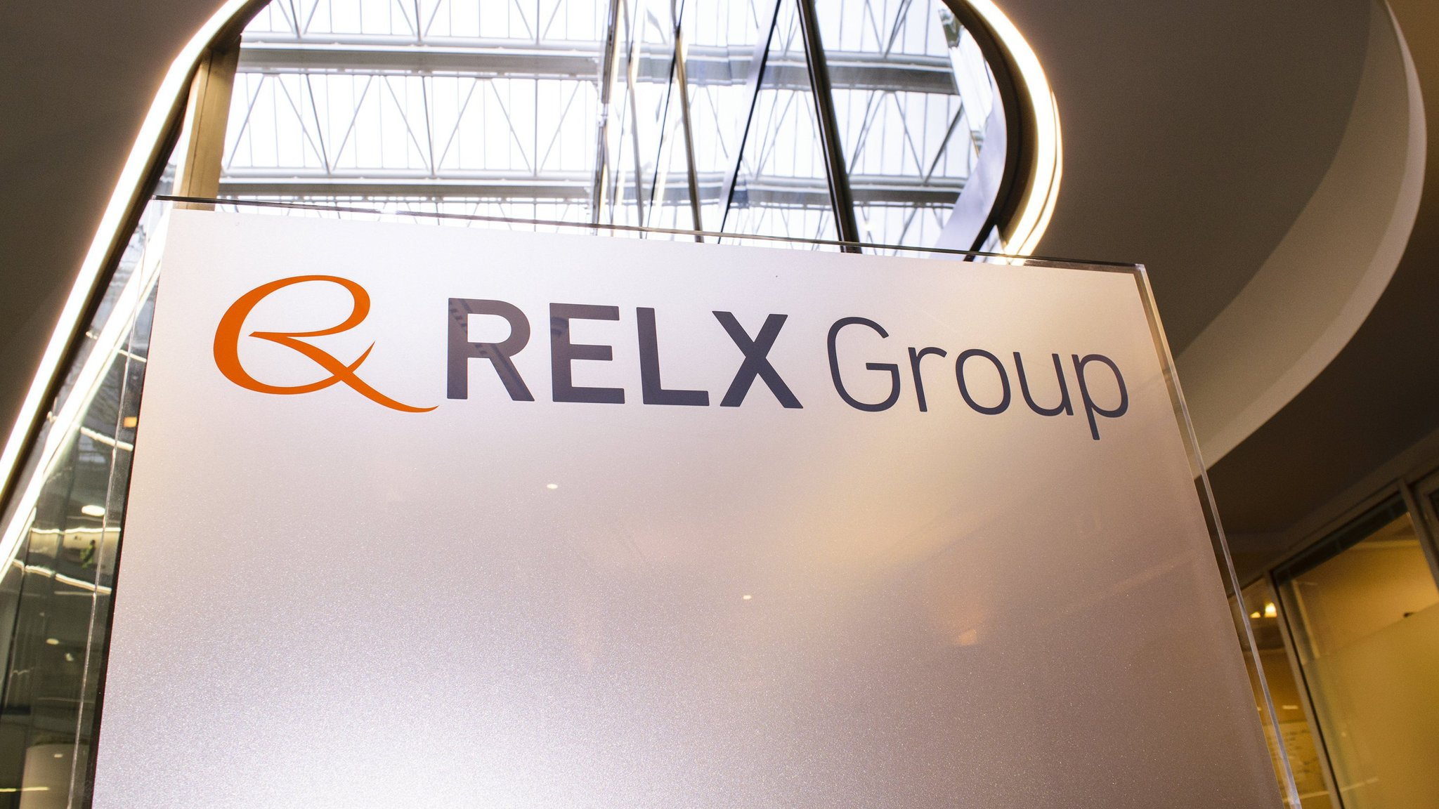 Relx logo and branding on a banner in a building