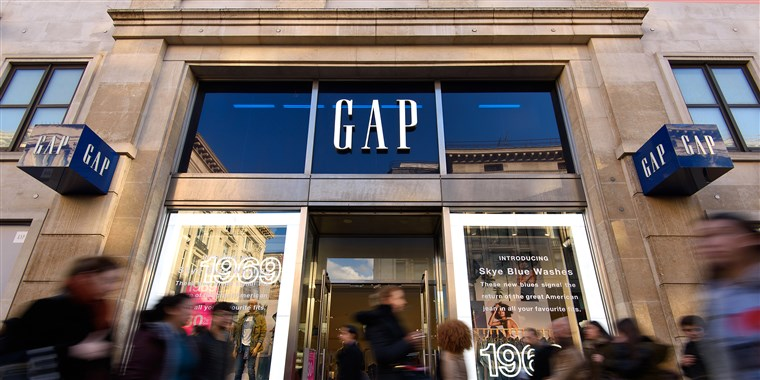 Gap store front on high street with shoppers rushing past