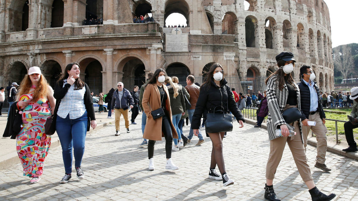 Tourists in Rome wearing masks to protect from coronavirus